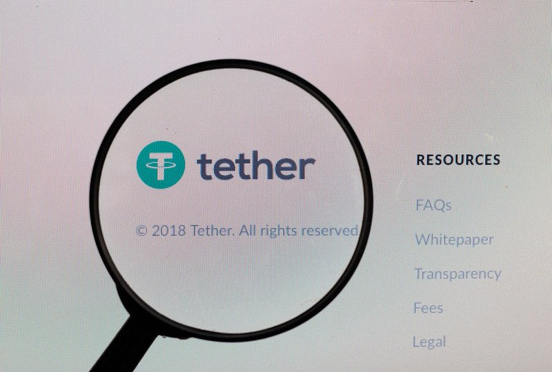 Magnifying glass over Tether logo